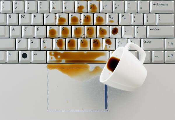 Drinks and food scraps on keyboard